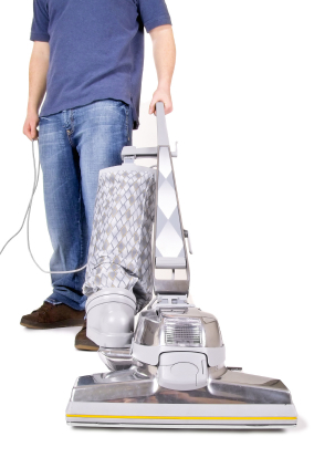 hoovering the carpet with a big old hoover