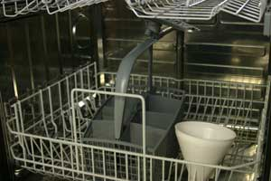 A typical dishwasher inside showing baskets and cutlery basket
