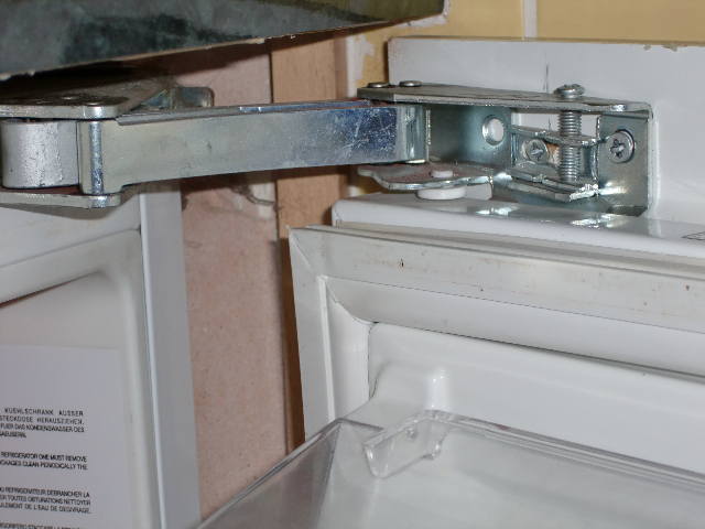 Integrated Fridge Door Hinge :: A typical Ingol hinge installed in an integrated undercounter fridge