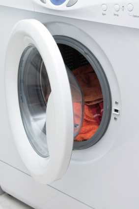 washing machine door open with clothes
