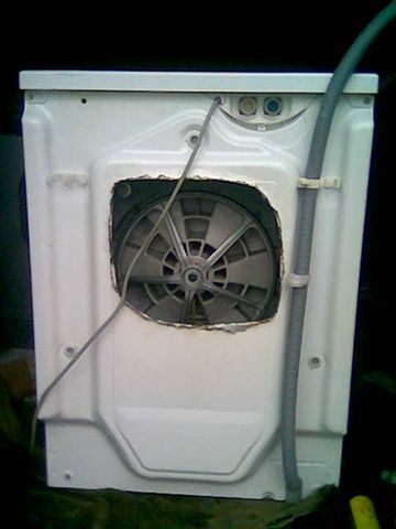 This is not how you get access to change a washing machine belt