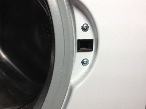 In behind these two screws is the door lock of the washing machine
